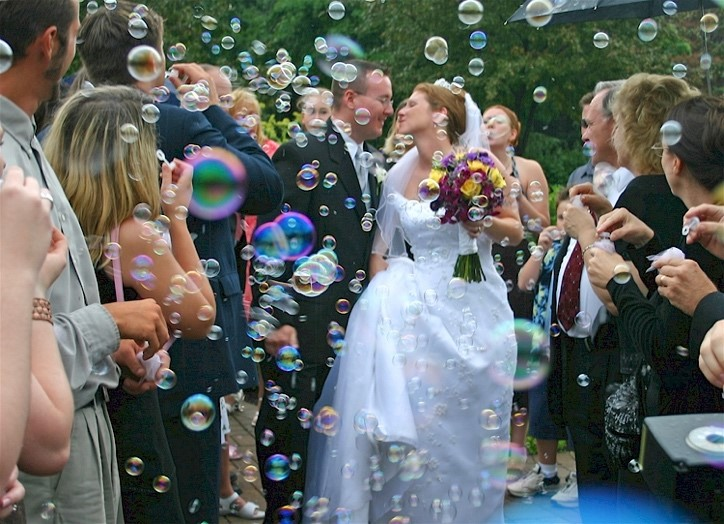 Couple walking among friends and bubbles