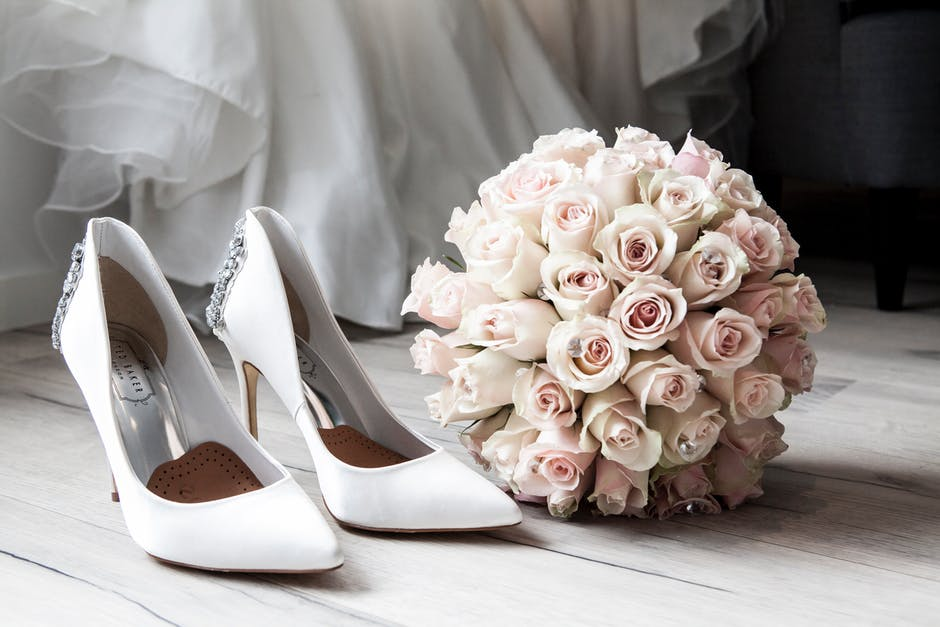 Pink bouquet and white shoes